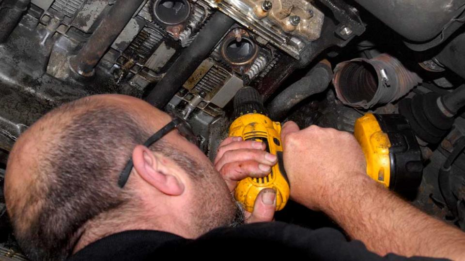 Ashley drills out snapped rusty exhaust manifold studs at Braunton