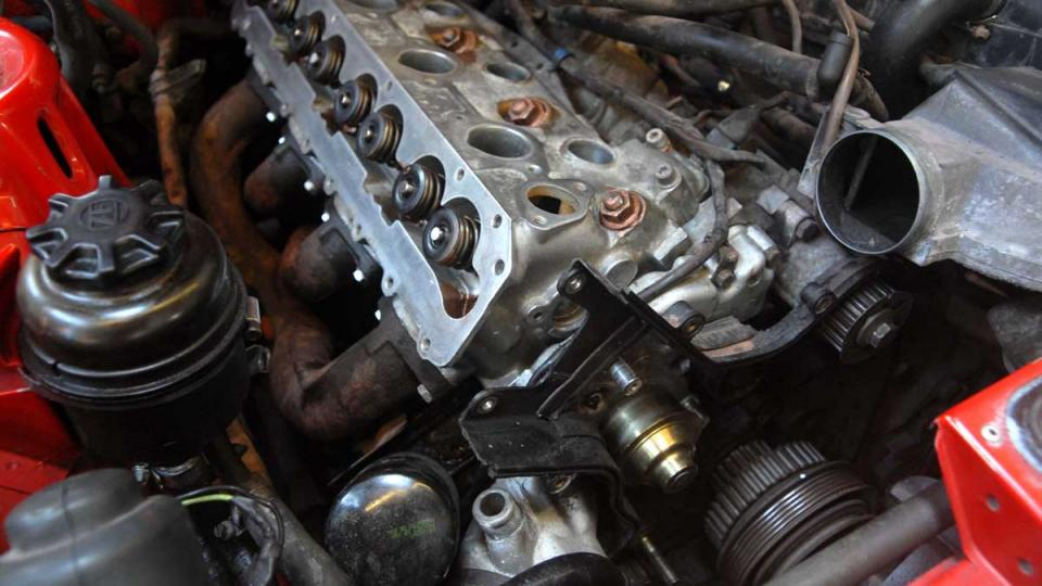 Porsche 944 8 valve head being fitted after head gasket replacement
