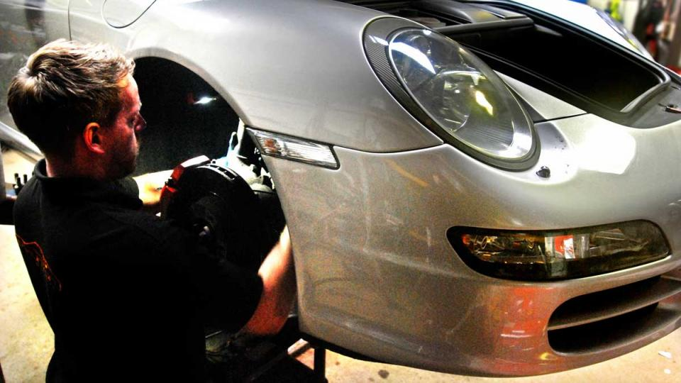fitting front cooling pipes and hoses to the Porsche 997