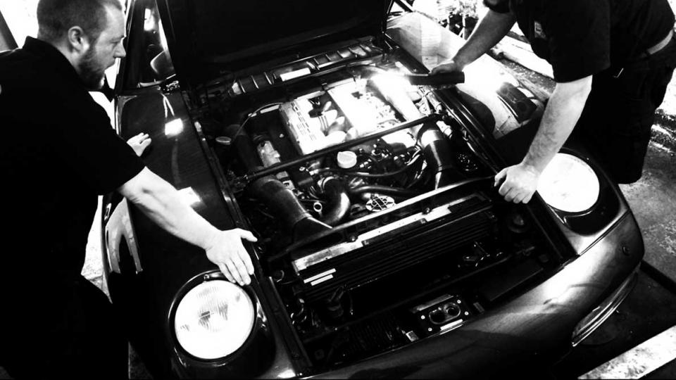 Ashley and Dave listen for an erratic noise from the Porsche 928 V8 engine