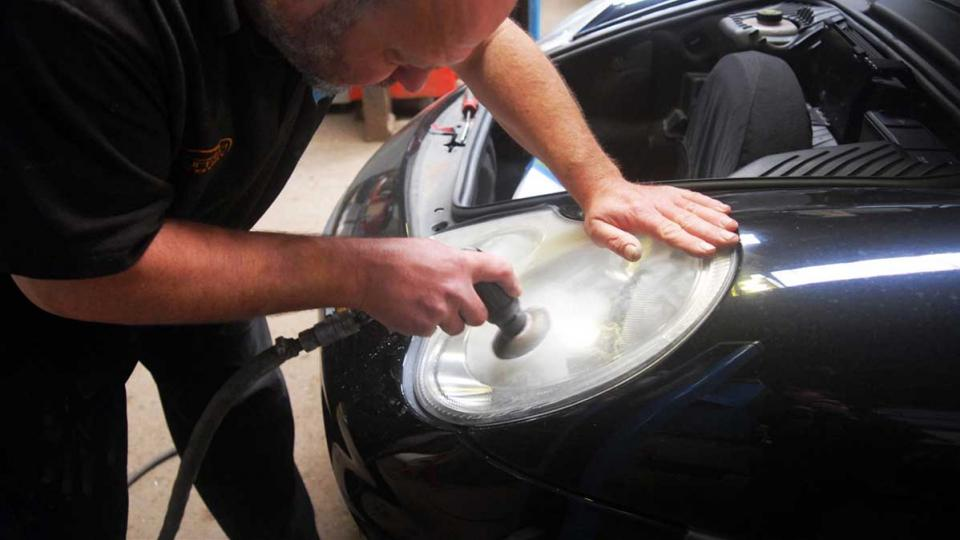 Ashley polishes the 996 911 headlight lens