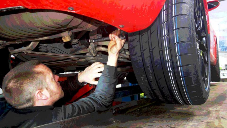 Adjusting wheel allignment on the rear of the Porsche Boxster