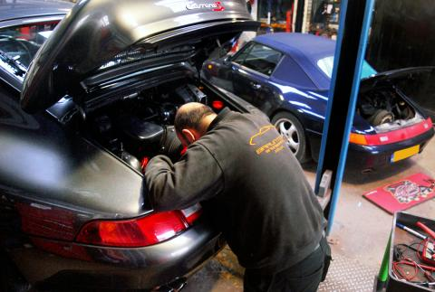 Ashley tends to a Porsche 993 with servicing and repair