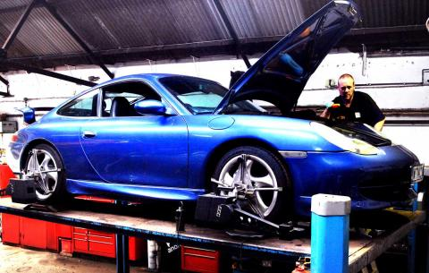 A 996 911 Porsche undergoes wheel alignment