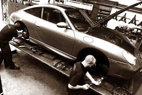 Dave and Matt work to fit new brakes to the Porsche 996 911