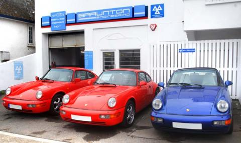 Porsche 964 in a line in front of the garage